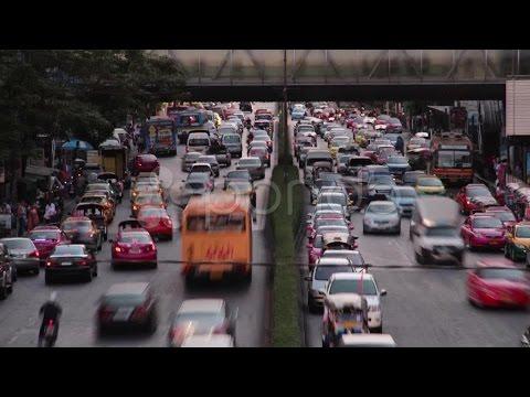 TRAFFIC TIME LAPSE: Bangkok  - Telephoto two lane road with pedestrian walkway. Stock Footage