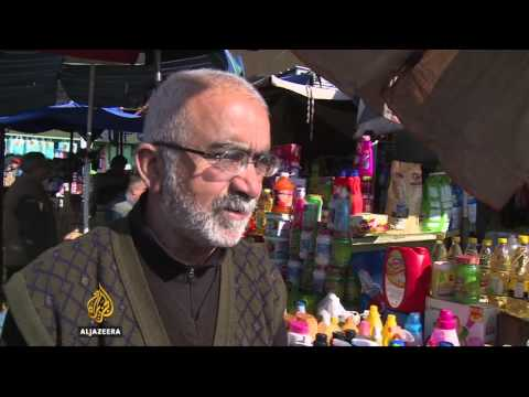 Iraq state employees feel pinch as economy struggles