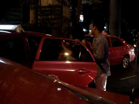 Drunk thai women in Silom, Bangkok, Thailand getting into a taxi with 2 other thai guys