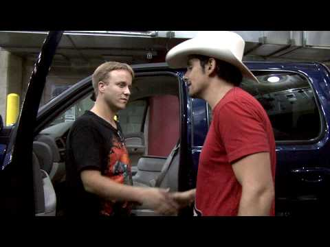 Brad Paisley gives a truck to the 1000000th Ticket Holder to the American Saturday Night Tour