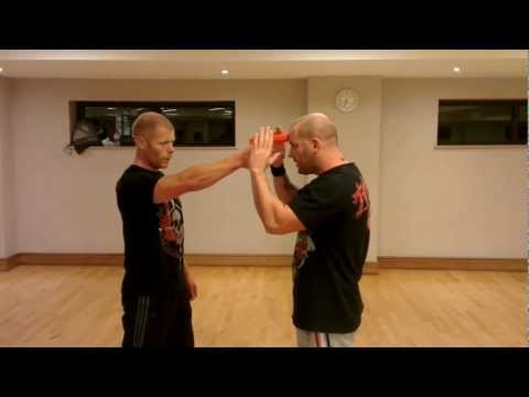 Urban Krav Maga disarming gun threat to head Image 1