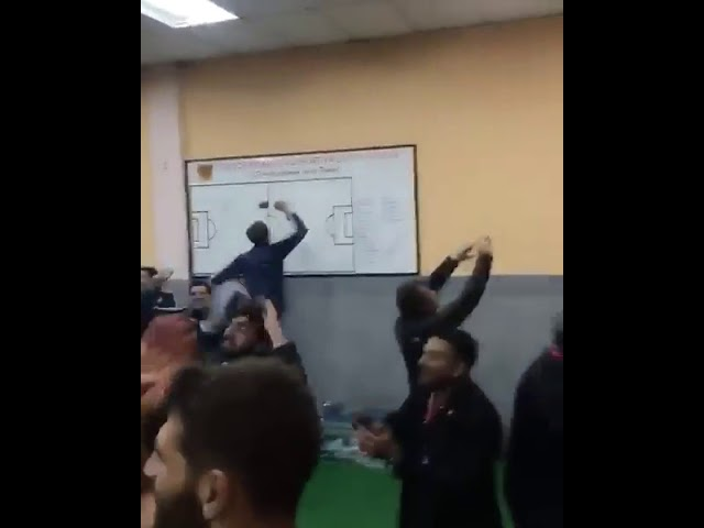 Argentina players singing and celebrating in the dressing room after qualifying for the World cup