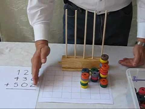 El Abaco Vertical y la Suma con tres dígitos.wmv