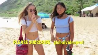 CUTE HAWAII BIKINI GIRL AT BEACH SHOWS HER BACKFLIP, HAWAII USA.