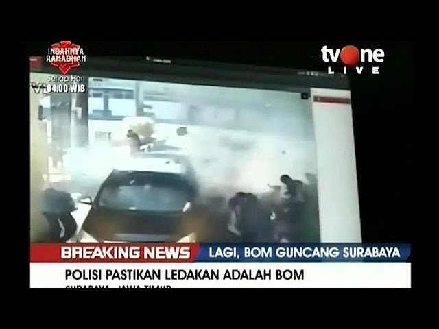 Indonesian police say sucide bombing family attacks Surabaya police headquarters