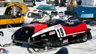a fantastic vintage snowmobile with snopro