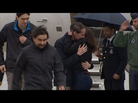 Three Spanish journalists return home after Syria kidnap ordeal