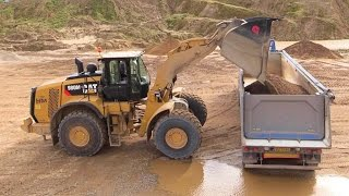 New Cat 980M Wheelloader Loading Volvo FH12 Semi Trucks