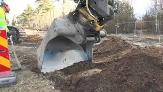 Volvo EC 380 DL excavator finds a cable under the ground in 2014
