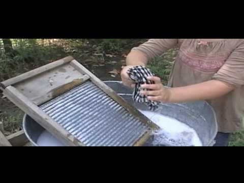 Alicia washing on a washboard