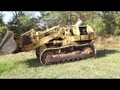 Cat 955 pushing a tree