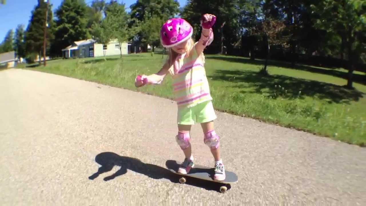 Little Kid Riding A Skateboard