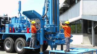 Download M.I.45 water wells drilling rig, 45 tons pull-back and carousel pipe loader 3Gp Mp4