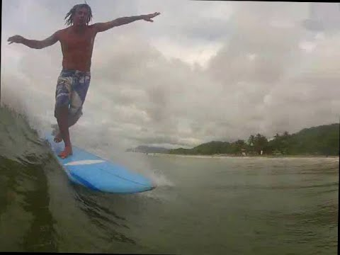 Surfing in Tamarindo costa rica on a cloudy day