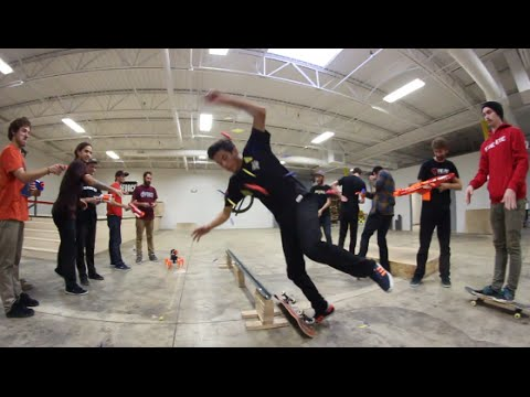 Skateboarding While Getting Shot With An Arsenal Of NERF GUNS!