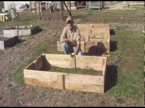 Building raised beds from re claimed pallet wood youtube for How to make garden beds from pallets