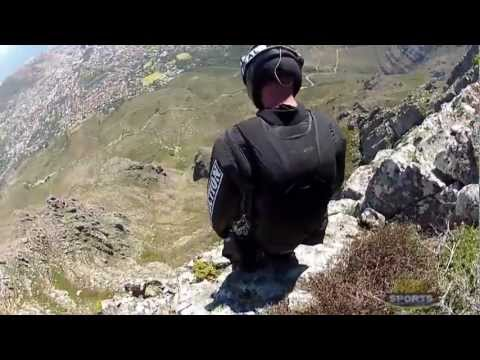 Sneak peek of wingsuiter Jeb Corliss crash into Table Mountain. Full video: http://www.youtube.com/watch?v=LEFCQRwj28w He didnt die, here he explained what ...