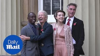 Emma Thompson receives her damehood in white trainers