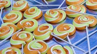 Hand Making Lollipops from Melted Sugar. Seen in Prague, Czech republic