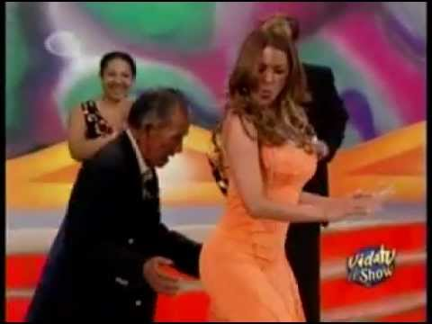 Galilea Montijo dancing in orange dress
