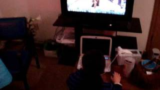 girl plays WOW on her TV