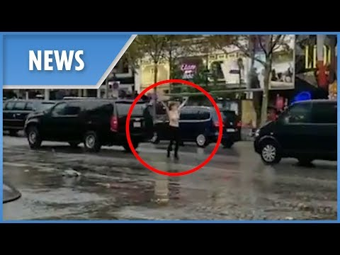 Topless activist throws herself at Trump's motorcade