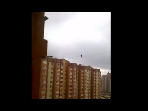 Daredevil walks 10-story-high tightrope without harness