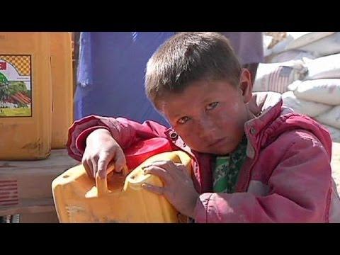 Afghan President Hamid Karzai visits landslide victims - no comment
