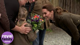 The Duchess of Cambridge admires a girl's hairstyle after trying plaits on Princess Charlotte