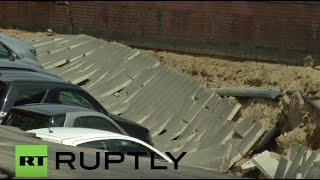 Italy: Massive sinkhole swallows TWENTY cars along Florence's Arno