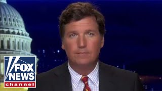 Tucker: Debate stage descends into chaos