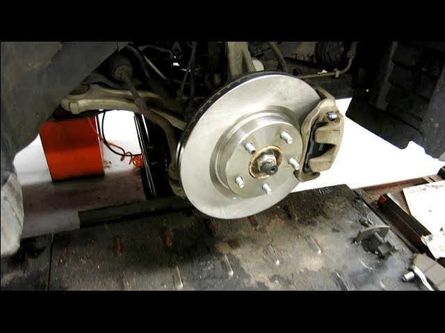 How to replace the front rotors and brake pads ... - YouTube