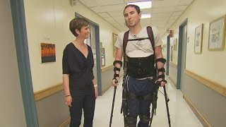 Robots help paralyzed people walk