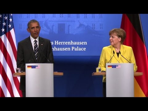 Obama, Merkel make case for disputed US-EU trade deal