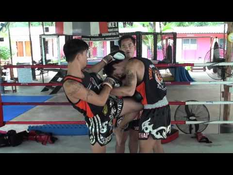 Tiger Muay Thai Techniques: Push front kick to leg to set up step forward knee strike Image 1