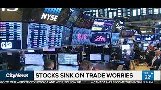 Business Report: Stocks fall on China-U.S. trade war worries