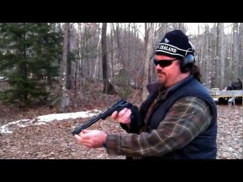 Shooting a paint can with a Thompson Encore 410 Barrel using 45 Colt Long shell