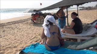 Candolim Beach,Goa, cows bother Russian girls