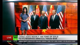China increases gold reserves, taxes US oil