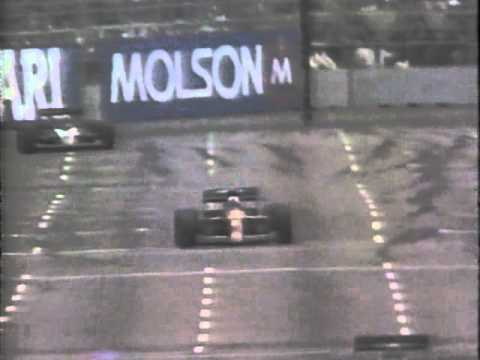 Nigel Mansell spins on his own oil after his engine blows and sets afire at Phoenix.