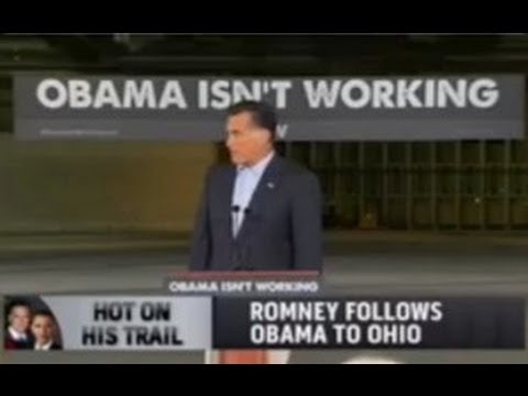 Is Romney's 'Obama Isn't Working' Banner Racist? Music Videos