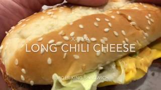 X-Tra Long Chili Cheese Burger King Sandwich hands on