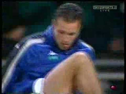 Lucas Neill stretching & spitting