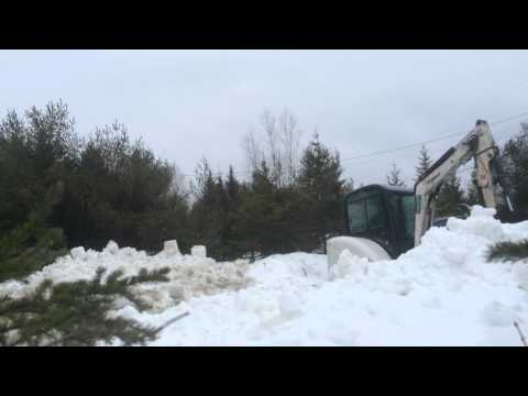 Moving snow with bobcat 325 compact excavator