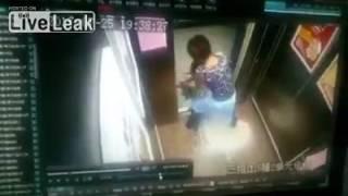 LiveLeak com   Girl holding hands with the elevator door