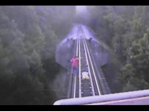 Women on Train Tracks Narrowly Escape Getting Hit
