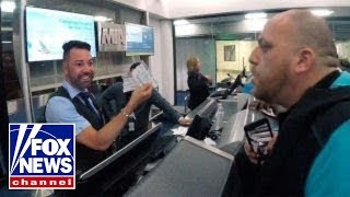 American Airlines passenger films argument with ticket agent