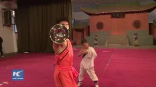 Chinese Kung Fu boy performs revolving stunt
