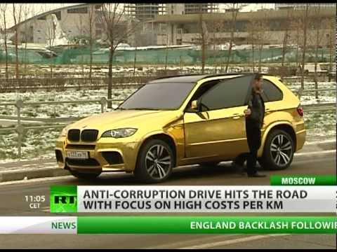 Cars made of gold bump along ruined Russian roads worth billions