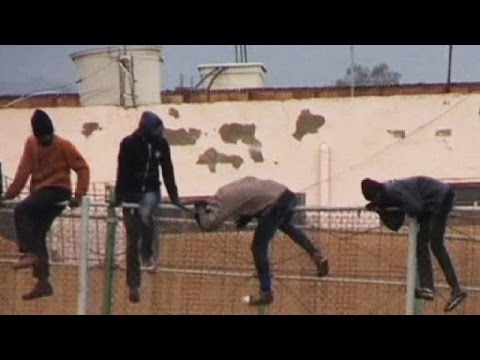 African migrants storm border into Spain - no comment
